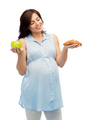 happy pregnant woman with apple and croissant
