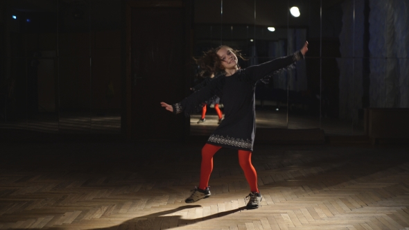 VideoHive Little Girl Dancing In Red Tights 18749601