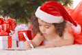 girl lying near Christmas tree