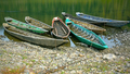 Old wooden boats moored to the bank of the river