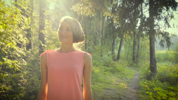 VideoHive Walking Girl In a Pink Dress In The Woods On a Sunny Day 18759603