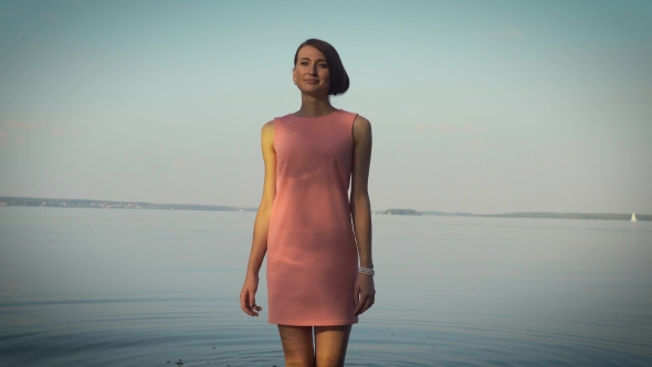 VideoHive Modest Girl Walking Near The Water Body 18759851