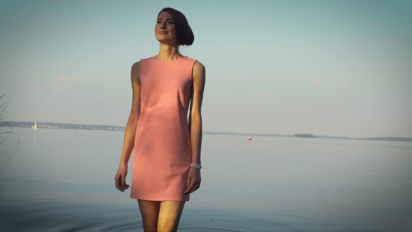 VideoHive Modest Girl Walking Near The Water Body 18759900