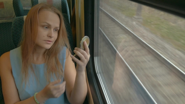 VideoHive Woman With Pocket-Glass In Train 18760160
