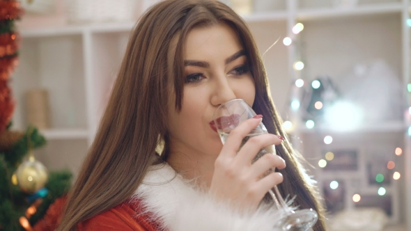 VideoHive Woman Dresses In Snow-maiden Suit Drinking Champagne In 18760271