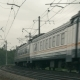 Suburban Train Moving Along The Railroad