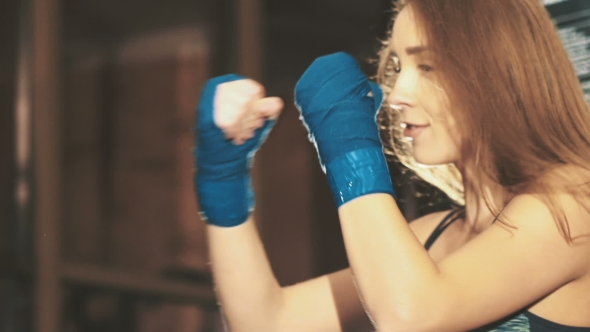 VideoHive Pretty Kickboxing Girl Training With Punching Bag In a Fitness Gym 18762901