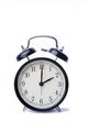 Black vintage alarm clock over the white background
