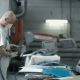Man Changes The Nozzle On a Grinding Machine.