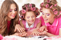 Mother and  daughters in hair curlers