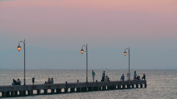 VideoHive People Enjoying Seascape From The Pier 18769281