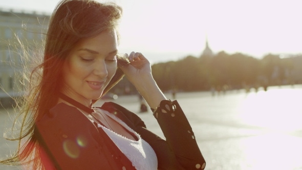 VideoHive Beatiful Young Woman Touching Her Hair And Smile 18769680