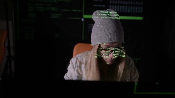 VideoHive Female Hacker Working At The Computer In Dark At Night Binary Code Projection On Her Face Slider 18771665