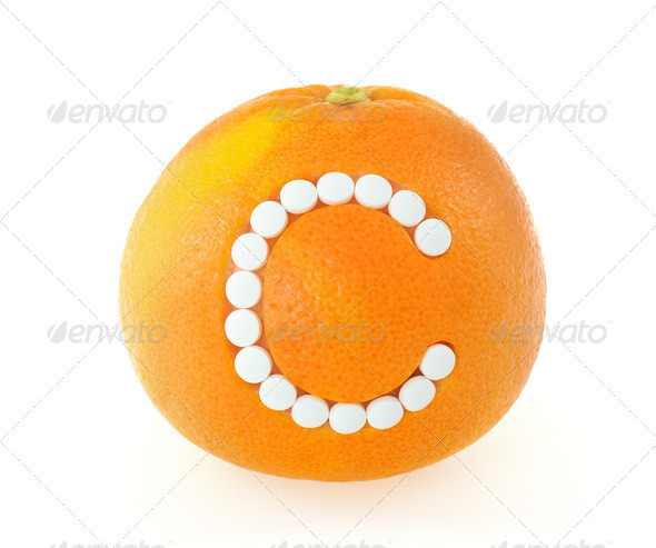 Grapefruit with vitamin c pills over white background - concept - Stock Photo - Images