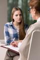 Mature psychologist talking with patient