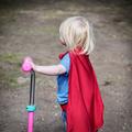 Superhero Baby Boy Using Scooter Adorable Concept