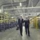 Two Businessmen Walking Through Factory