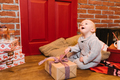 child enjoys the gifts for Christmas, birthdays