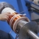 Transformer, Engine Production. Worker Winding Cooper Wires On a High Voltage Transformer. Slider
