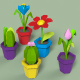 Low poly flowers in pot.
