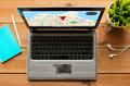 close up of laptop computer with gps navigator map