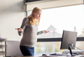 pregnant businesswoman stressing at office work