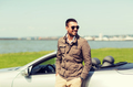 happy man near cabriolet car outdoors