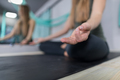 Woman Doing Yoga Exercises In Gym, Closeup Sport Fitness Girl Sitting Lotus Pose