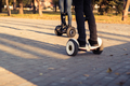 Male legs on electrical scooter outdoors gyroscooter