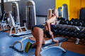 Girl exercising with dumbbell