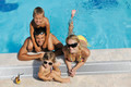 happy young family have fun on swimming pool - PhotoDune Item for Sale