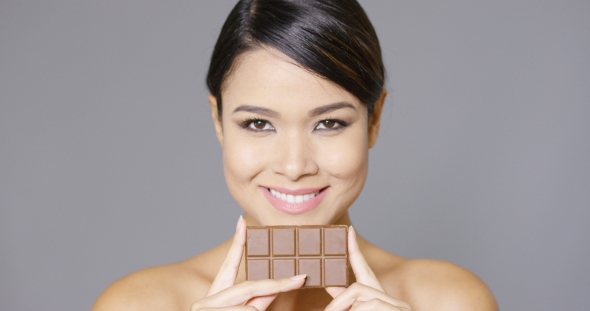 Download Beautiful Smiling Woman Holding Chocolate nulled download