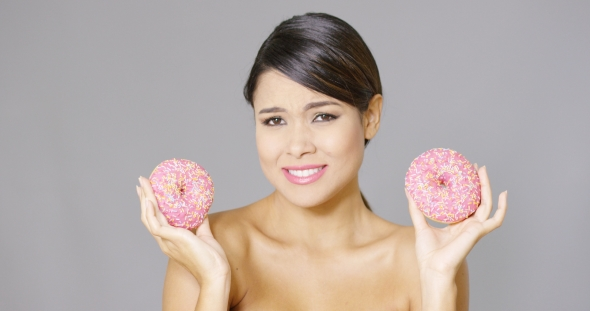 Download Happy Vivacious Woman Holding Two Pink Donuts nulled download