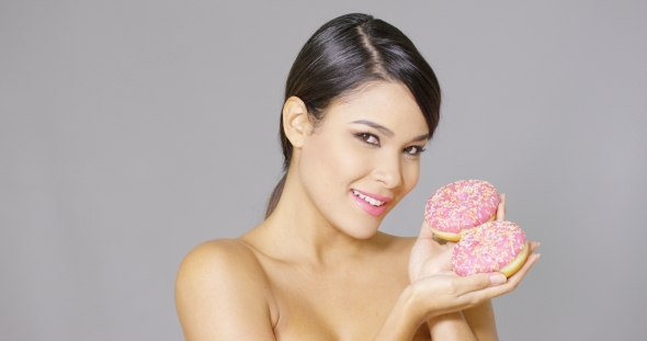 Download Gorgeous Smiling Woman Holding Donuts nulled download