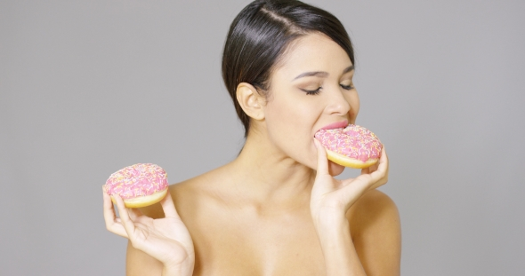 Download Gorgeous Woman Eating Donuts nulled download