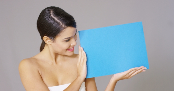 Download Happy Woman Looking At Blue Card In Her Hands nulled download
