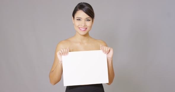 Download Smiling Female Looking Over At White Card In Hand nulled download