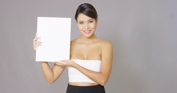 Download Lady Holding a Large Blank Card In Her Hands nulled download