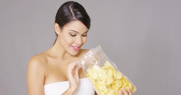 Download Happy Woman Grabbing Potato Crisps nulled download