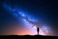Beautiful Milky Way with standing woman. Colorful night sky