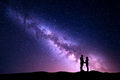 Milky Way with silhouette of people. Landscape with night sky