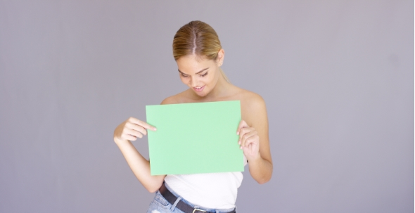 Download Attractive Blond Woman Holding a Blank Green Sign nulled download