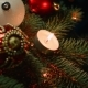 Christmas Decorations on the Christmas Tree with Candles on a Background Garlands