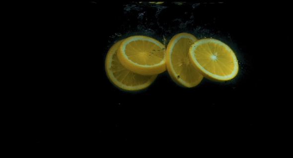 VideoHive Oranges Falling Into Water in on Black Background 18892963