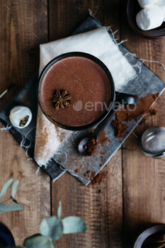 Overhead View of Hot Chocolate Drink in Mug Sprinkled with Cinnamon on Vintage Napkins