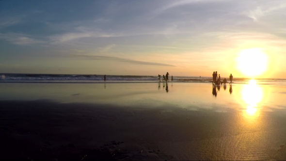 VideoHive View of People Having Fun on Beach During Sunset 18923407