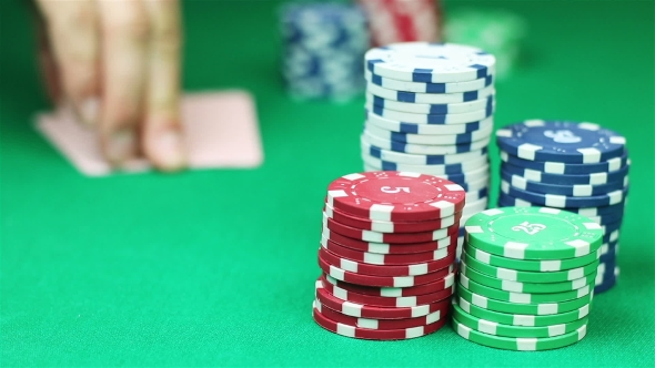 VideoHive Poker Player Shows His Good Pair Hand for Win and Doing Bet 18923853
