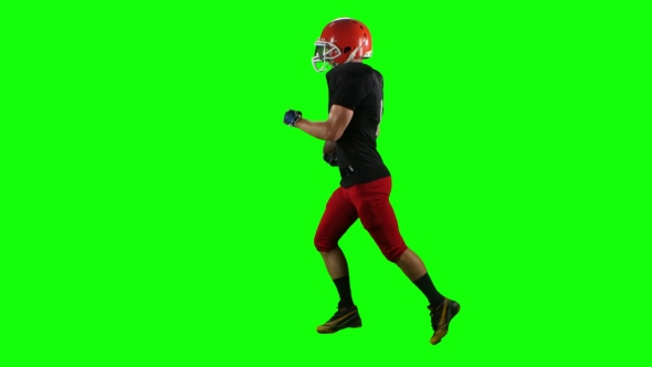 VideoHive Football Player Running with the Ball in His Helme 18928075