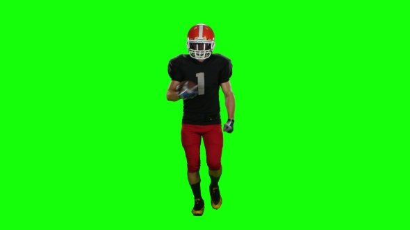 VideoHive Player Is Running in a Red Helmet with the Ball in His Hands 18928105