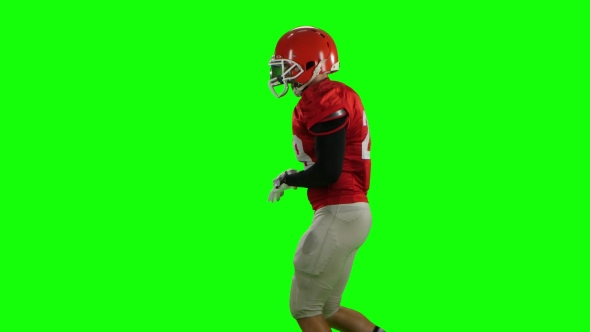 VideoHive Athlete Runs in Protective Gear with Helmet and Gloves Green Screen 18928586